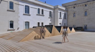 The Vincent Van Gogh Foundation is the result building, facade, floor, flooring, outdoor structure, property, roof, gray