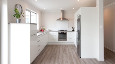 Settle into your comfort zone with this kitchen countertop, floor, flooring, hardwood, home, interior design, kitchen, laminate flooring, real estate, room, wood flooring, white