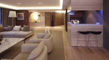 In this contemporary apartment renovation, woodgrain surfaces from ceiling, interior design, room, suite, brown, gray