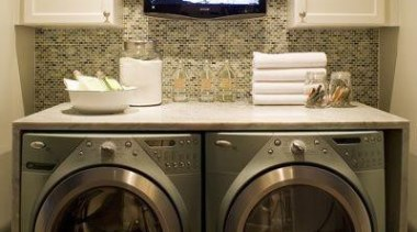 Utilitarian spaces such as laundry rooms and mudrooms clothes dryer, furniture, home appliance, laundry, laundry room, major appliance, room, washing machine, brown, orange