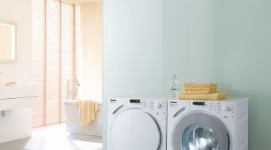 A peaceful and large laundry room with appliances bathroom, clothes dryer, home appliance, interior design, laundry, laundry room, major appliance, product, product design, room, washing machine, white, gray
