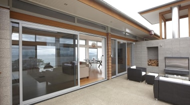 Sheltered, private outdoor spaces can still take in door, house, interior design, property, real estate, window, white, gray