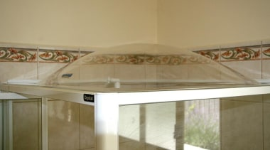 Any sharp edges are then cleaned up with architecture, ceiling, daylighting, floor, glass, interior design, property, brown