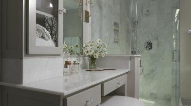 We reconfigured this Master Bathroom to be a bathroom, bathroom accessory, bathroom cabinet, cabinetry, countertop, floor, home, interior design, room, sink, gray, black