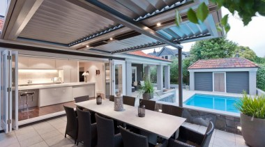 View of the kitchen from the exterior - daylighting, house, interior design, patio, property, real estate, roof, gray