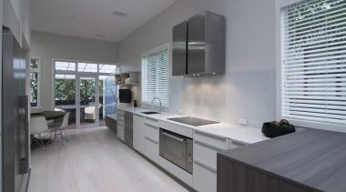 The double dishwasher and sleek oven are embedded countertop, interior design, kitchen, real estate, gray