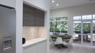 Large windows allow ample light into the kitchen architecture, interior design, kitchen, property, real estate, window, gray