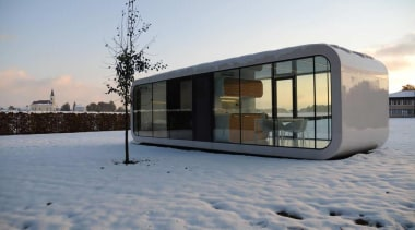 Coodo is a German mobile home modular system architecture, building, facade, home, house, sky, snow, window, winter, gray