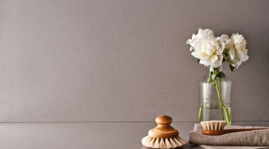 A warm grey with a distinctive texture delivering product design, still life, still life photography, table, vase, gray