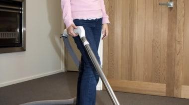 Girl Vacuuming - Girl Vacuuming - floor | floor, flooring, joint, leg, shoulder, standing, vacuum, vacuum cleaner, gray, brown