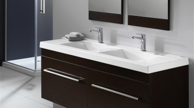 Squared external edges paired with a sweeping basin angle, bathroom, bathroom accessory, bathroom cabinet, bathroom sink, chest of drawers, furniture, plumbing fixture, product, product design, sink, tap, gray, black