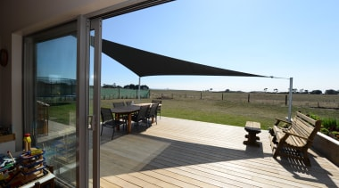 Shade sail Home built by Fowler Homes Taranaki deck, house, outdoor structure, property, real estate, black, teal