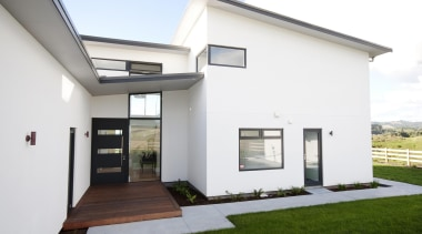 Striking modern lines and a welcoming entry to architecture, estate, facade, home, house, property, real estate, residential area, window, white