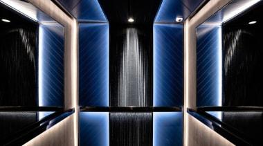 It's a true celebration of Art Deco architecture, light, lighting, symmetry, black, blue