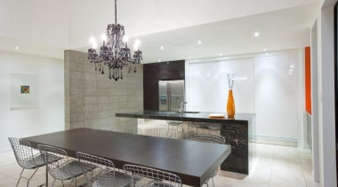 Glamour and drama is created by the black ceiling, countertop, dining room, interior design, kitchen, property, real estate, table, gray, white
