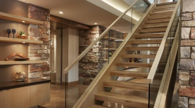 This new house, designed by Charles R Stinson interior design, shelving, stairs, brown