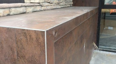 Exterior detail featuring Oxide Moro. - Creyke House furniture, wall, wood stain, gray, brown