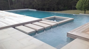 Concrete pool with feature stepping stones to built composite material, daylighting, leisure, outdoor furniture, property, sunlounger, swimming pool, water, water resources, white