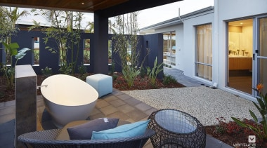 Backyard features outdoor bathtub opposite master bedroom. architecture, backyard, courtyard, estate, home, house, interior design, patio, property, real estate, window, black, gray