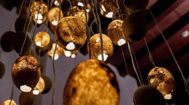 The Tranquility Nodes made from sand are packed light fixture, lighting, black