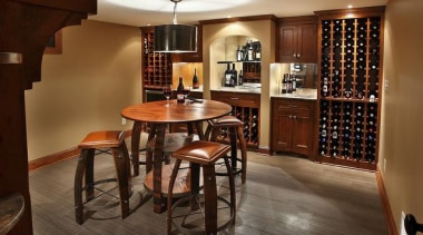 Because of its expansive and wide-open layout, a cabinetry, dining room, floor, flooring, furniture, hardwood, interior design, room, table, wood, brown