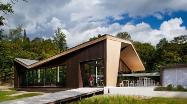 The Mont-Tremblant national park discovery centre in Québec architecture, cottage, home, house, pavilion, real estate, gray, brown