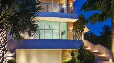 The Hink residence in Fort Lauderdale is a apartment, architecture, arecales, building, condominium, estate, facade, hacienda, home, hotel, house, landscape lighting, lighting, majorelle blue, mansion, palm tree, property, real estate, residential area, resort, sky, villa, blue