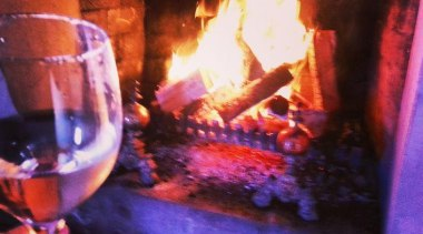 At Mantell's - Photo by Kelly Cook - campfire, fire, flame, hearth, heat, wood burning stove, red