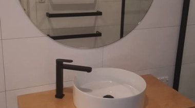 Sleek black tapware with timber top. Note the bathroom, plumbing fixture, sink, tap, toilet, toilet seat, gray