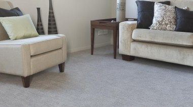 Combines a two-colour thick and thin yarn with carpet, chair, coffee table, floor, flooring, furniture, hardwood, interior design, laminate flooring, living room, loveseat, table, tile, wood, wood flooring, gray