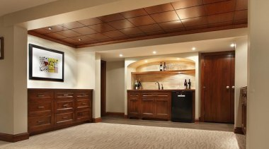 Because of its expansive and wide-open layout, a cabinetry, ceiling, floor, flooring, hardwood, interior design, laminate flooring, real estate, room, wood, wood flooring, brown, orange