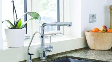 Pacific combines layers of veining in beige, brown, bathroom, countertop, floor, flooring, interior design, kitchen, plumbing fixture, room, sink, tap, tile, white