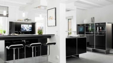 Modern Black and White KitchenFor more information, please floor, furniture, interior design, kitchen, office, white, gray