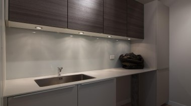 This kitchen's secondary sink is enhanced by sufficient cabinetry, countertop, interior design, kitchen, sink, gray, black