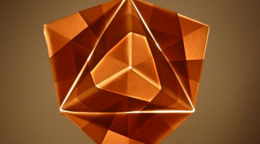 A range of folded metallic fabrics  are art paper, lampshade, lighting, lighting accessory, orange, origami, origami paper, product design, symmetry, brown
