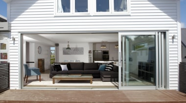Increased indoor outdoor flow with large sliding doors. door, home, house, interior design, window, white, gray
