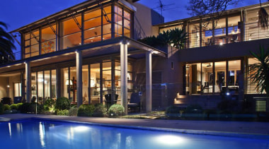 Evening Rear View - Evening Rear View - architecture, building, estate, facade, family car, home, house, landscape lighting, lighting, mansion, mixed use, property, real estate, residential area, swimming pool, villa, window, blue