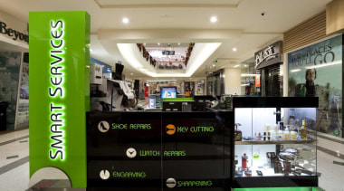 Kiosk with a green signage and green neon interior design, product, retail, black
