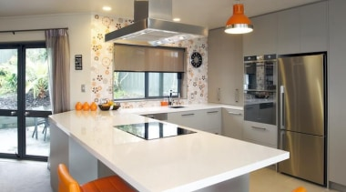 This fun kitchen features Smeg appliances bought from countertop, furniture, interior design, kitchen, room, table, gray