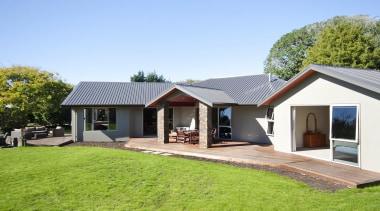 This home is built by Fowler Homes Taranaki.Fowler backyard, cottage, estate, facade, farmhouse, home, house, property, real estate, siding, villa, yard, teal, green