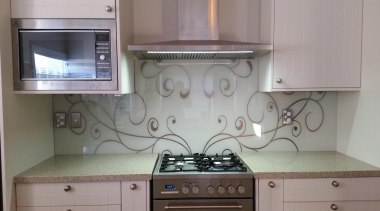 Patterned Glass Splashback.  The customer wanted their cabinetry, countertop, floor, flooring, home, home appliance, kitchen, kitchen appliance, kitchen stove, major appliance, room, tile, gray