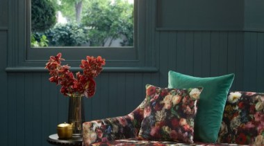 Flowerbomb features a majestic, ethereal bouquet of peonies, chair, couch, furniture, home, house, interior design, living room, wall, window, wood, black