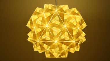 A range of folded metallic fabrics  are lampshade, light fixture, lighting, lighting accessory, origami, product design, symmetry, yellow, brown