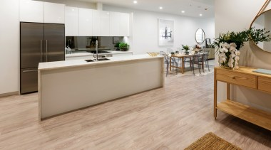 The TIDA NZ Architect-designed apartment winner – Paul floor, flooring, hardwood, interior design, kitchen, laminate flooring, tile, wood, wood flooring, gray