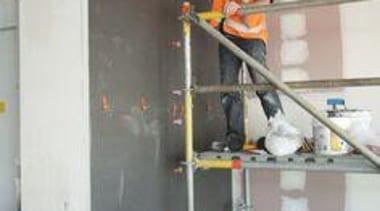 Installation of Naturali basalto vena scura on walls. gray