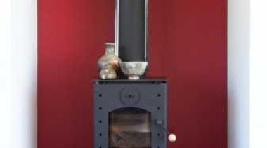 Chimney with red feature wall and low wooden fireplace, hearth, home appliance, kitchen stove, stove, wood burning stove, red, white