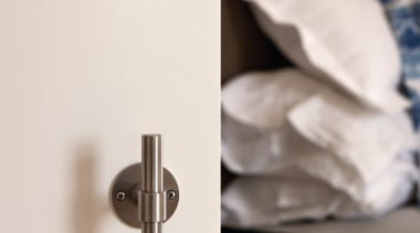 PBT20/50 - Solid Sprung Lever Handle Attached to furniture, product design, white