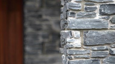 The Designa Schist column system makes it so brick, stone wall, structure, texture, wall, window, wood, gray, black