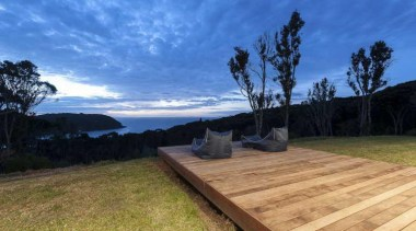 Wooden deck facing out to the waters - cloud, estate, grass, house, landscape, property, real estate, sky, tree, blue