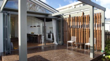 Decking provides an open outdoor living space. - architecture, facade, house, property, real estate, siding, black, blue